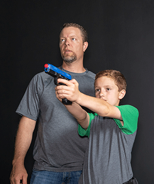 Father and son learning to virtually shoot